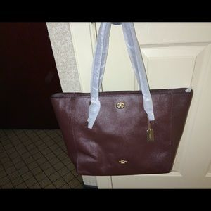 NWT COACH burgundy leather bag. 12 in by 13 in.